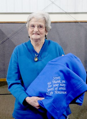 LYNN KUTTER ENTERPRISE-LEADER LIFE Ministries honored Joyce Cooksey, who has volunteered 25 years with the non-profit organization in Prairie Grove. She is retiring as an active volunteer but will still serve on the Board of Directors.