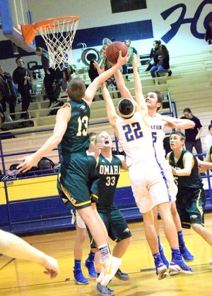Westside Eagle Observer/MIKE ECKELS Garrett Matlock (Omaha 13) fights for an Eagle rebound with Decatur's Garry Wood (22) and Levi Newman (15, in front of Wood) during the Decatur-Omaha conference game at Peterson Gym in Decatur Jan. 30.
