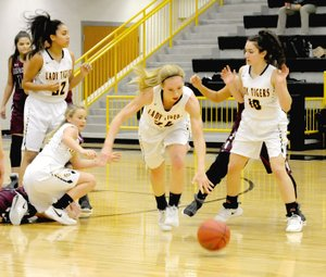 MARK HUMPHREY ENTERPRISE-LEADER Prairie Grove senior Sarah James-Stone comes out of a scramble for a loose ball with the dribble gaining possession for the Lady Tigers. Prairie Grove needed overtime to beat Lincoln, 58-50, Friday.