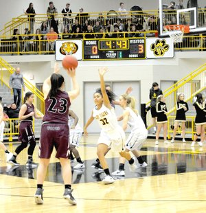 MARK HUMPHREY ENTERPRISE-LEADER Lincoln senior Tristan Cunningham had the hot hand in the first half, nailing a trio of 3-pointers, including this shot. Cunningham scored 16 points in the Lady Wolves' 58-50 overtime loss to Prairie Grove Friday.