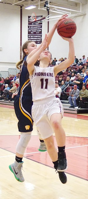 Westside Eagle Observer/RANDY MOLL Gentry sophomore Ahrya Reding attempts a shot against Haas Hall during Jan. 30 play at Gentry High School.