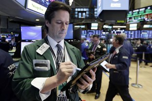 Trader Patrick McKeon works on the floor of the New York Stock Exchange on Wednesday. Stocks are opening modestly higher on Wall Street as the market stabilizes following three days of tumult. (AP Photo/Richard Drew)