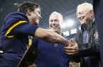 Highland Park quarterback John Stephen Jones, left, Jerry Jones, right and Stephen Jones, middle, celebrate a UIL Class 5A Division I state championship football game against Temple, Saturday, Dec. 17, 2016, in Arlington, Texas. Highland Park won 16-7. John Stephen Jones is the grandson of Dallas Cowboys owner Jerry Jones and son to Stephen Jones. (AP Photo/Jim Cowsert)