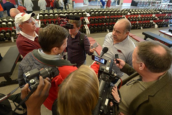 Arkansas defensive coordinator John Chavis is interviewed by reporters Wednesday, Feb. 7, 2018, in Fayetteville.