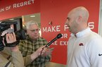 Arkansas assistant coach Barry Lunney speaks Wednesday, Feb. 7, 2018, with members of the media in the Fred W. Smith Football Center on the university campus in Fayetteville.