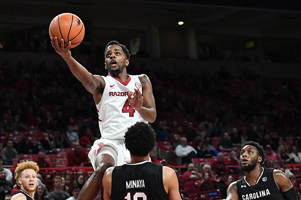 Arkansas' Daryl Macon (4) shoots a layup during a game against South Carolina on Tuesday, Feb. 6, 2018, in Fayetteville.