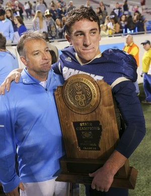 In this file photo Pulaski Academy football coach Kevin Kelley and quarterback Layne Hatcher (right) celebrate their 5A High School Football State Championship against McClellan.
