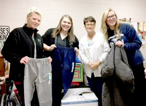 Photo Submitted Nursing students Sarina Hunt (left) and Maegan Mooberry, McDonald County High School nurse Tracy Allman, and nursing student Brittney Jackson show donated items.