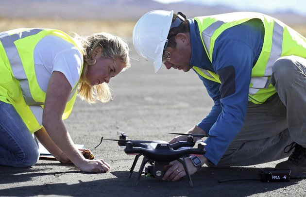 jessica-balik-left-and-keven-gambold-right-ceo-of-unmanned-experts-prepare-a-drone-for-a-demonstration-at-the-searchlight-airport-in-searchlight-nev-on-wednesday-jan-17-2018-ap-photoisaac-brekken