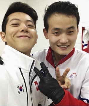 This February 2018 selfie provided by South Korean figure skater Alex Kam and posted on Instagram, shows him, left, posing with North Korean skater Kim Ju Sik in Gangneung, South Korea, ahead of the 2018 Winter Olympics.