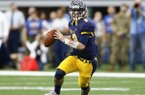 Highland Park quarterback John Stephen Jones (9) looks to pass against Temple during the first half of UIL Class 5A Division I state championship football game, Saturday, Dec. 17, 2016, in Arlington, Texas. (AP Photo/Jim Cowsert)