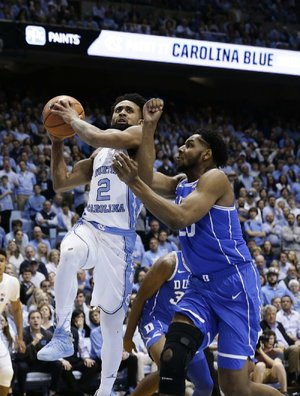 North Carolina's Joel Berry II (left) scored 21 points in the No. 21 Tar Heels' 82-78 victory over No. 9 Duke on Thursday night in Chapel Hill, N.C.