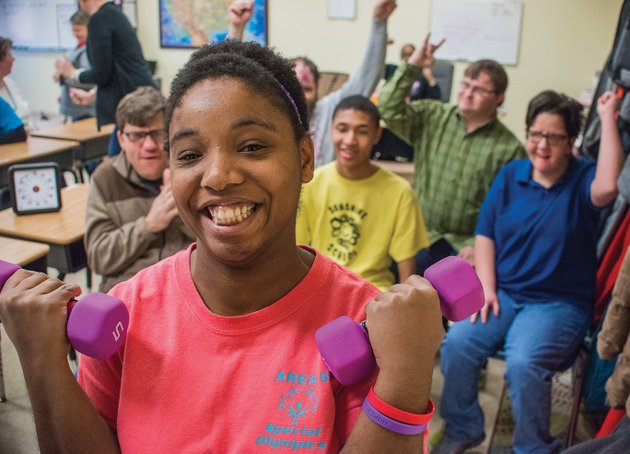 jessica-sears-works-out-with-small-weights-as-her-classmates-at-the-sunshine-school-cheer-her-on-sears-has-been-named-to-team-arkansas-for-the-2018-special-olympics-usa-games-in-july-she-will-compete-in-powerlifting