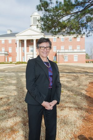 Melissa Taverner stands in the middle of the Lyon College campus in Batesville. Taverner recently started as the new provost and dean of faculty at the Independence County college. She previously served as interim provost at Emory and Henry College in Emory, Va.