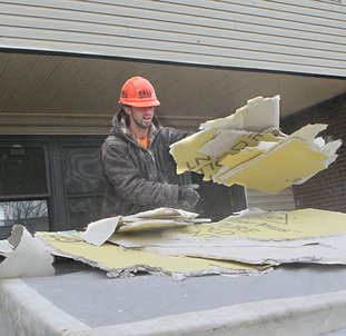 The Sentinel-Record/Richard Rasmussen PROJECT OVERHAUL: Matt Clark of Rall Construction Co. removes old drywall Friday from inside an Eastwood Heights unit of the Hot Springs Housing Authority.