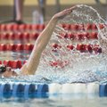 Fayetteville High School's Olivia Keith competes in the girls 200-yard individual medley Friday duri...