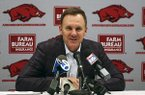 Arkansas coach Chad Morris speaks to reporters during a news conference Thursday, Feb. 8, 2018, in North Little Rock.