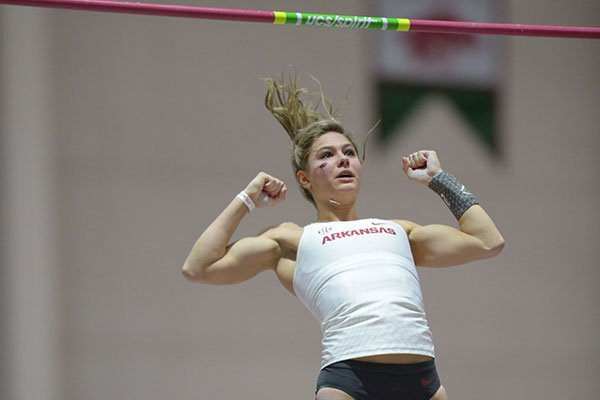Arkansas' Lexi Jacobus competes in the pole vault invitational Saturday, Feb. 10, 2018, during the Tyson Invitational in the Randal Tyson Track Center in Fayetteville.
