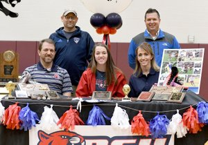 Bud Sullins/Special to Siloam Sunday Siloam Springs senior Audrey Maxwell signed to play soccer Wednesday at Rogers State University in Claremore, Okla. Pictured are: Front from left, father Joel Maxwell, Audrey Maxwell, mother Amy Maxwell; back, Arkansas Comets coach Bill Bernie and Siloam Springs head coach Brent Crenshaw.