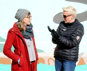 Janelle Jessen/Siloam Sunday Amanda Brinkman, right, host of Small Business Revolution, interviewed Kelsey Howard, director of Main Street Siloam Springs, during Brinkman's tour of downtown Siloam Springs on Jan. 17. Siloam Springs is one of 10 communities in the running to be featured on the HULU show Small Business Revolution -- Main Street Season 3. Brinkman is expected to announce the top five finalists in a Facebook live video on Feb. 13. The public will then have a week to vote for their favorite town and a winner will be announced at the end of the month. The winning town will receive $500,000 for revitalization and marketing advice from Small Business Revolution experts.