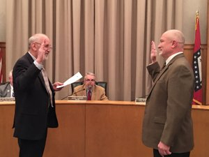 Courtesy photo Reid Carroll, right, is sworn in as the newest member of the Siloam Springs Board of Directors after winning a runoff election last month.