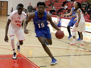 Photo courtesy of Mid-America Christian John Brown freshman Densier Carnes drives to the basket against Mid-America Christian on Thursday in Oklahoma City. The Evangels defeated the Golden Eagles 89-66.