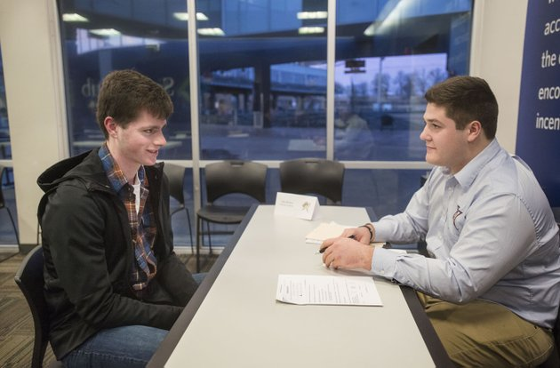 jake-youngs-left-of-rogers-sits-down-for-an-interview-thursday-with-tyler-burson-northwest-arkansas-naturals-clubhouse-assistant-during-the-annual-northwest-arkansas-naturals-job-fair-at-arvest-ballpark-in-springdale-springdale-residents-approved-a-bond-issue-and-1-cent-sales-tax-in-2006-that-paid-for-construction-of-arvest-ballpark-and-don-tyson-parkway-among-other-projects