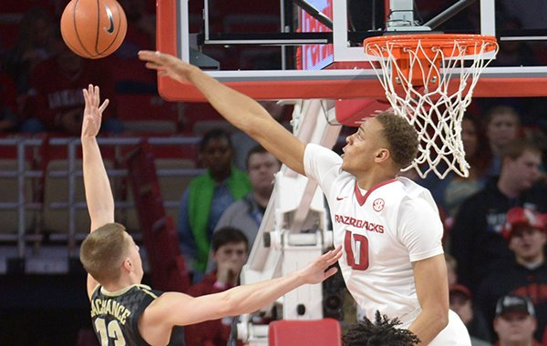 Arkansas' Daniel Gafford (10) reaches to block a shot by Vanderbilt's Riley LaChance Saturday, Feb. 10, 2018, during the first half of play in Bud Walton Arena in Fayetteville.