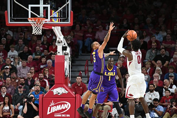 Arkansas' Jaylen Barford takes a shot while Louisiana State's Daryl Edwards (5) defends Wednesday Jan. 10, 2018 at Bud Walton Arena in Fayetteville.