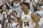 Texas A&M center Tyler Davis (34) reacts after a foul against Kentucky during the first half of an NCAA college basketball game Saturday, Feb. 10, 2018, in College Station, Texas. (AP Photo/Sam Craft)