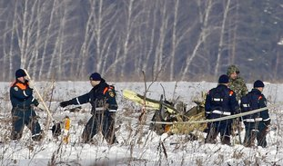The Associated Press CRASH SCENE: Personnel work at the scene of a AN-148 plane crash in Stepanovskoye village, about 40 kilometers (25 miles) from the Domodedovo airport, Russia. A Russian passenger plane carrying 71 people crashed Sunday near Moscow, killing everyone aboard shortly after the jet took off from one of the city's airports. The Saratov Airlines regional jet disappeared from radar screens a few minutes after departing from Domodedovo Airport en route to Orsk, a city some 1,500 kilometers (1,000 miles) southeast of Moscow.
