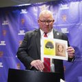 Rogers Police Chief Hayes Minor holds up a picture of Grant Hardin, a suspect in a cold case, during...
