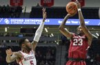 Arkansas guard C.J. Jones (23) shoots for a 3-pointer over Mississippi guard Markel Crawford (5) during the second half of an NCAA college basketball game in Oxford, Miss., Tuesday, Feb. 13, 2018. (Petre Thomas/The Oxford Eagle via AP)