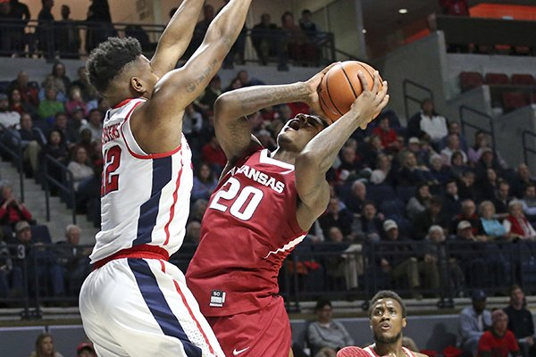 Arkansas forward Darious Hall (20) shoots as Mississippi forward Bruce Stevens (12) defends during the second half of an NCAA college basketball game in Oxford, Miss., Tuesday, Feb. 13, 2018. (Petre Thomas/The Oxford Eagle via AP)