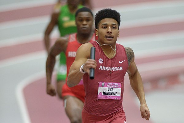 Arkansas' Obi Igbokwe competes in the 4x400-meter relay Saturday, Feb. 10, 2018, during the Tyson Invitational in the Randal Tyson Track Center in Fayetteville.