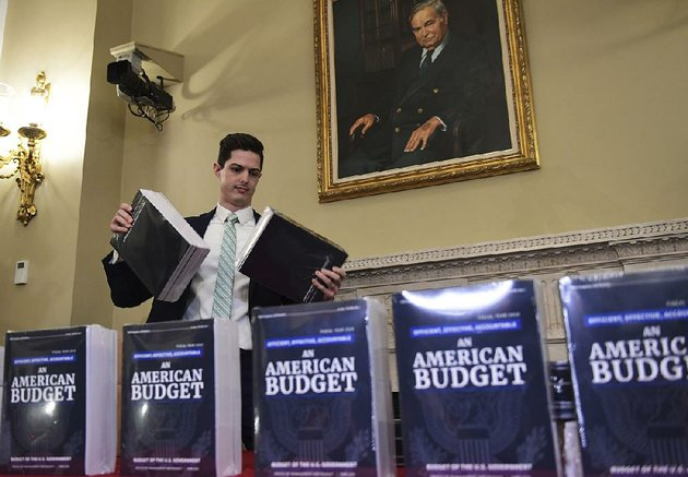 james-knable-helps-to-unpack-copies-monday-of-the-presidents-fy19-budget-after-it-arrived-at-the-house-budget-committee-office-on-capitol-hill