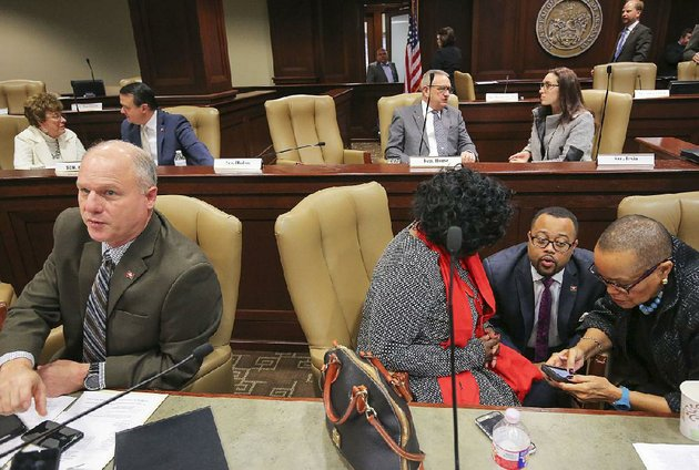 sen-jim-hendren-left-and-fellow-budget-task-force-member-sen-joyce-elliott-right-join-sen-linda-chesterfield-and-rep-charles-blake-at-a-joint-budget-committee-meeting-tuesday