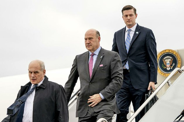 president-donald-trumps-chief-of-staff-john-kelly-left-white-house-chief-economic-adviser-gary-cohn-center-and-then-white-house-staff-secretary-rob-porter-right-arrive-at-andrews-air-force-base-md-thursday-feb-1-2018