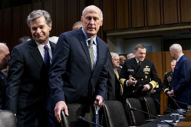 fbi-director-christopher-wray-left-and-director-of-national-intelligence-dan-coats-arrive-tuesday-to-testify-before-the-senate-intelligence-committee-wray-said-the-fbi-is-undertaking-a-lot-of-specific-activities-to-counter-russian-meddling-but-was-not-specifically-directed-by-the-president
