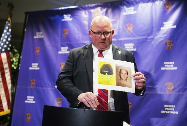 rogers-police-chief-hayes-minor-holds-up-a-picture-of-grant-hardin-suspect-in-a-cold-case-during-a-news-conference-monday-at-the-rogers-police-station