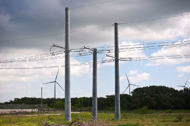transmission-lines-stand-near-a-wind-power-project-in-texas-a-transmission-line-project-across-missouri-is-proving-the-complexity-of-linking-wind-generated-power-to-areas-of-demand