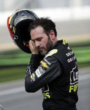 Jimmie Johnson removes his helmet after qualifying for the Daytona 500 on Sunday at Daytona International Speedway in Daytona Beach, Fla. Johnson, coming off the worst season of his career, is gearing up for a shot at his eighth NASCAR championship.
