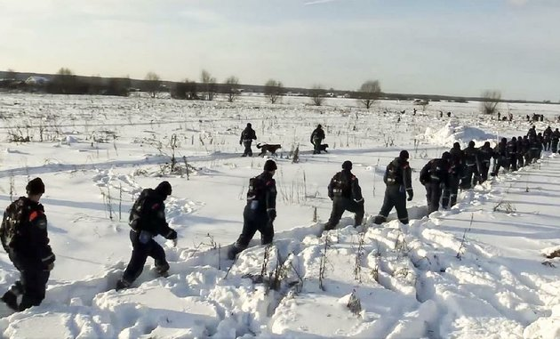 in-this-photo-provided-by-the-russian-emergency-situations-ministry-emergency-teams-head-to-the-scene-of-an-an-148-plane-crash-near-the-village-of-stepanovskoye-on-monday