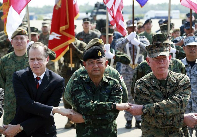 us-ambassador-to-thailand-glyn-davies-from-left-thai-defense-forces-chief-thanchaiyan-srisuwan-and-lt-gen-lawrence-nicholson-join-hands-for-a-photo-tuesday-in-rayong-province-thailand