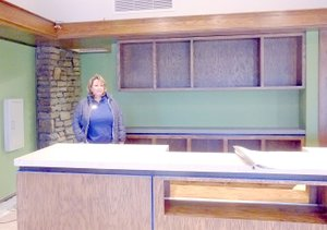 Lynn Atkins/The Weekly Vista Leslie Terry, the POA's merchandising and retail manager, stands behind the main counter of what will be the new pro shop inside the Country Club building.