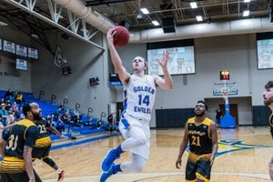 Photo courtesy of JBU Sports Information John Brown University's Jake Caudle soars in for two of his game-high 24 points during an 83-72 win against Science & Arts (Okla.) at Bill George Arena on Saturday.