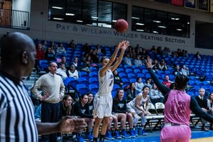 Photo courtesy of JBU Sports Information John Brown University's Kimmy Deines pulls up for a 3-point shot attempt during the Golden Eagles' 70-60 win against Science & Arts (Okla.) inside Bill George Arena on Saturday.