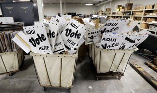 Bins of signs are seen in a storage are at the Bear County Election offices, Tuesday, Feb. 13, 2018, in San Antonio. The first primaries of the 2018 elections are less than a month away, but efforts to safeguard the vote against expected Russian interference are lagging. Texas will hold the first primary of 2018 on March 6. (AP Photo/Eric Gay)
