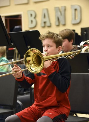 NWA Democrat-Gazette/FLIP PUTTHOFF Colton Neal plays trombone on Tuesday during a music class at Pea Ridge High School. A millage election held Tuesday to pay for a new high school was approved by voters.