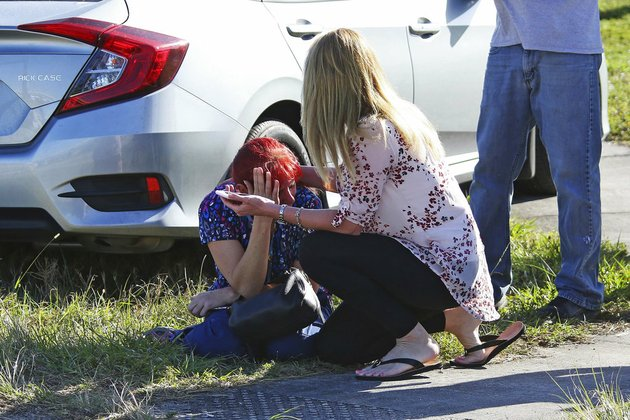 a-woman-consoles-another-as-parents-wait-for-news-regarding-a-shooting-at-marjory-stoneman-douglas-high-school-in-parkland-fla-on-wednesday-feb-14-2018